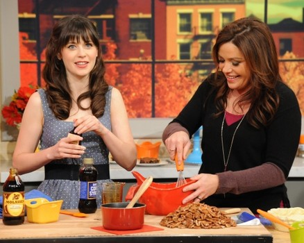 Rachael Ray and Zooey Deschanel cooking away. This is how it's done y'all.