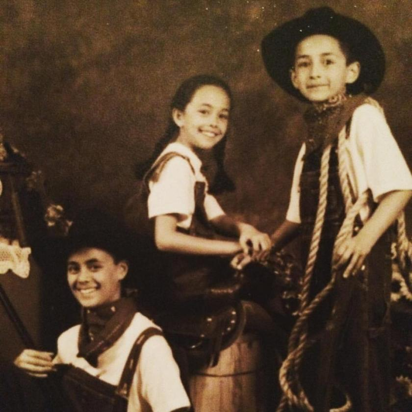 A photo of myself with bro and sis dressed in Western-American garb.