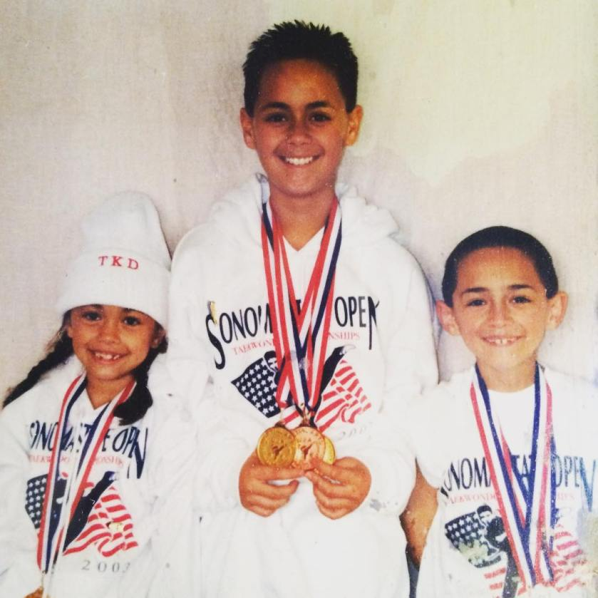A photo with bro and sis with Tae Kwon Do medals because we are winners duh.